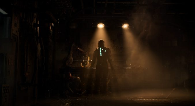 A figure in a space suit, featuring a neon blue strip of light on their spine, stands in a dimly lit industrial room.